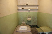 Prison cell with cot, toilet, and sink. Alcatraz prison, California. - Photo #22133