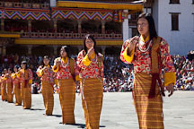 Row of female folk dancers. Thimphu tsechu, Bhutan. - Photo #22525