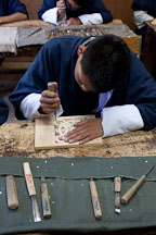 Student carving wood block at the National Institute for Zorig Chusum. Thimphu, Bhutan. - Photo #22915