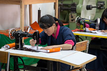 Student using sewing machine at the National Institute for Zorig Chusum. Thimphu, Bhutan. - Photo #22903