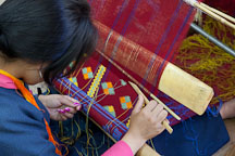Student weaving a geometric pattern. National Institute for Zorig Chusum, Thimphu, Bhutan. - Photo #22926