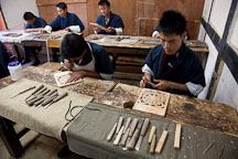 Young male students in the wood carving classroom. National Institute for Zorig Chusum, Thimphu, Bhutan. - Photo #22912