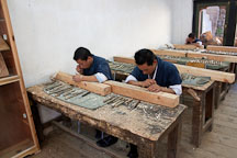 Students working in a wood carving classroom. National Institute for Zorig Chusum, Thimphu, Bhutan. - Photo #22896