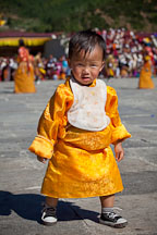 Toddler walking in the courtyard at Thimphu tsechu festival. - Photo #22690