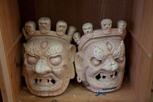 Unpainted masks with minature skulls. National Institute for Zorig Chusum, Thimphu, Bhutan. - Photo #22894