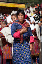 Woman with baby at the Thimphu tsechu festival. - Photo #22474