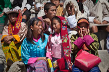 Young girl and mother sitting in the crowd at Thimphu tsechu festival. - Photo #22518