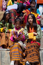 Young women watching the dances at the Thimphu tsechu festival. - Photo #22627