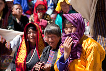 Young women wearing a shawl to protect herself from the harsh sun. Thimphu tsechu, Bhutan. - Photo #22625