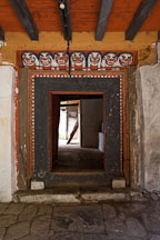 Doorway to enter Cheri Monastery with snow lion carvings. Thimphu valley, Bhutan. - Photo #23073
