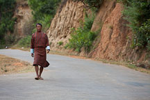 Man walking to town along the road. Punakha, Bhutan. - Photo #23269