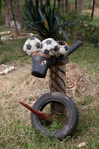 Odd figure made from soccer balls, tires, and a wood stake. Punakha, Bhutan. - Photo #23309