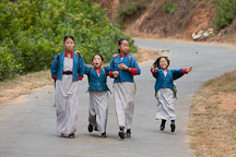 Young children walk to school in the early morning. Punakha, Bhutan. - Photo #23247