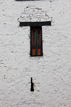 Arrow slit and window at Rinpung Dzong. Paro, Bhutan. - Photo #24031