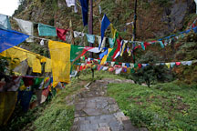 Prayer flags crossing the steps to the Tiger's Nest monastery. Paro, Bhutan. - Photo #24154