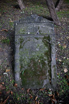 Fallen moss covered gravestone in the Old Jewish Cemetery. Prague, Czech Republic. - Photo #29526