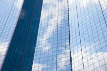 Clouds and sky reflected on the glass windows of the Hyatt Regency. Dallas, Texas. - Photo #25203