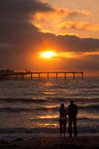 Couple on Ocean beach at sunset. San Diego, California. - Photo #26189