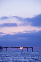 Setting sun just over the horizon at Ocean beach pier. San Diego, California. - Photo #26199
