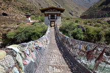 Restored iron bridge with sides covered in prayer flags. South of Paro, Bhutan. - Photo #22329