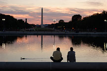 Friends sitting by the Capitol reflecting pool. Washington Monument. Washington, D.C. - Photo #1835