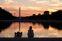 Couple relaxing in front of the Capitol reflecting pool. Washington, D.C. - Photo #1838