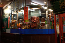 Duck and pork meat hanging in the window of chinatown restaurant, Melbourne, Australia. - Photo #1529