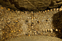 Skulls and bones stacked to the ceiling in the catacombs. Paris, France. - Photo #31547