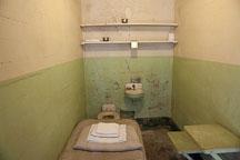Prison cell with cot, toilet, and sink. Alcatraz prison, California. - Photo #22133