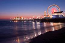 Bright lights of the Santa Monica pier and ferris wheel. Santa Monica, California, USA. - Photo #8334