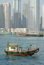 Small fishing boat in Victoria Harbor. Hong Kong, China. - Photo #15634