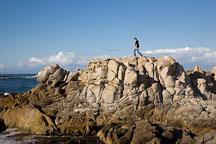 Teenager hiking over coastal rocks. Pacific Grove, California. - Photo #19535