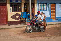 Family riding a motorcycle taxi. Puerto Maldonado, Peru - Photo #9036