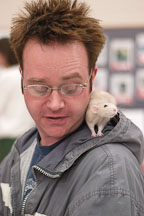 An attendee provides a suitable perch for a pet rat. The Wonderful World of Rats, San Mateo, California, USA. - Photo #6037