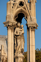 Statue of the Virgin Mary in the flower garden of Notre Dame Cathedral. Paris, France. - Photo #30938
