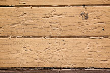 Chinese characters carved into wood and painted over. Angel Island Immigration Station. - Photo #22039