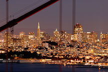 San Francisco skyline as seen through the cables of the Golden Gate Bridge. San Francisco, California, USA. - Photo #11739