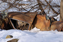 Abandoned car in snowbank. McFarland park. Ames, Iowa. - Photo #2395