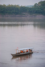 Boat ferrying tourists. Madre de Dios river, Peru, South America, vertical - Photo #9004