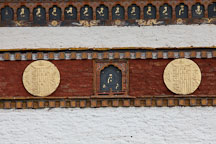 Slate carving and gilded relief disks at Druk Wangyal Chorten. - Photo #23204