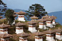 The Druk Wangyal chorten are arranged in layers on a small knoll. Dochu La, Bhutan. - Photo #23140