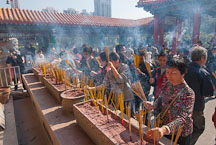 Large crowds of people light incense for their ancestors at the Wong Tai Sin Temple. Hong Kong, China. - Photo #15740