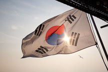 Taegukgi, the flag of the Republic of Korea, waves in the breeze on a boat in the harbor at Wolmido in Incheon, South Korea. - Photo #20140