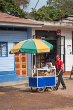 Young man with food cart. Puerto Maldonado, Peru. - Photo #9041