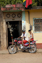 Male driver and a female passenger on a motorcycle taxi. Puerto Maldonado, Peru. - Photo #9042