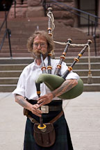 Musician playing bagpipes. Toronto, Canada. - Photo #19642
