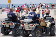Police sitting on ATVs. Manhattan Beach, Los Angeles, California, USA. - Photo #7342