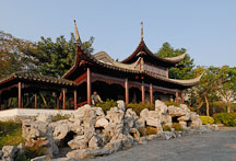 Two-storey Mountain View Pavilion with limestone rocks in front. Kowloon walled city park. Hong Kong. - Photo #15544