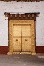 Golden doors in the second courtyard of Punakha Dzong. Punakha, Bhutan. - Photo #23446