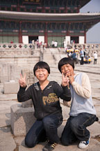 Korean schoolchildren stop to pose for a picture in front of Geunjeongjeon during a tour of Gyeongbok Palace in Seoul, South Korea. - Photo #20946